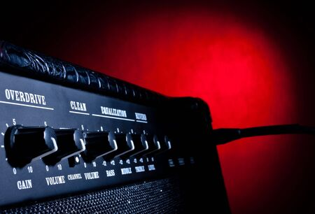 combo amplifier closeup on red background photo