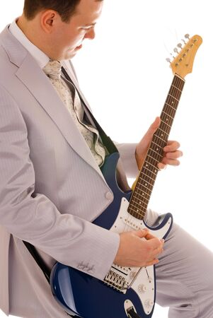 stratocaster: man in white suit playing guitar, white background