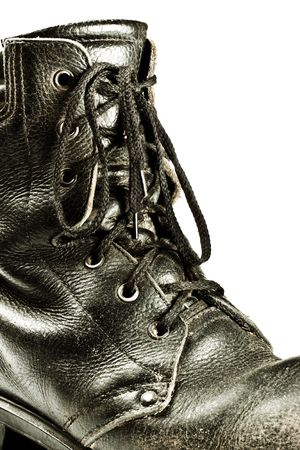 old army style boot closeup isolated on white photo