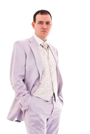 attractive young man in wedding suit isolated on white photo
