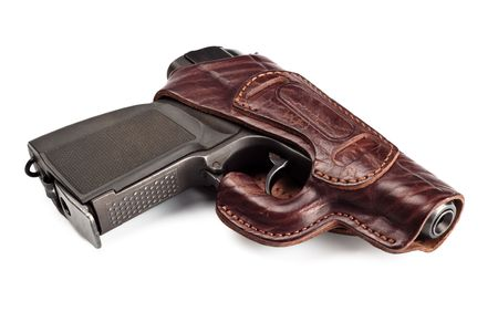 vintage pistol in leather holster isolated on white photo