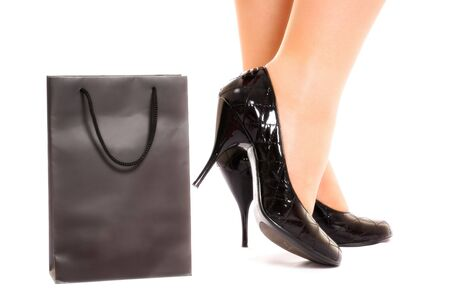 women legs in fashion shoes near shopping bag isolated on white Stock Photo - 6338919