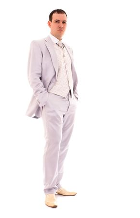 young man in wedding suit isolated on white background photo