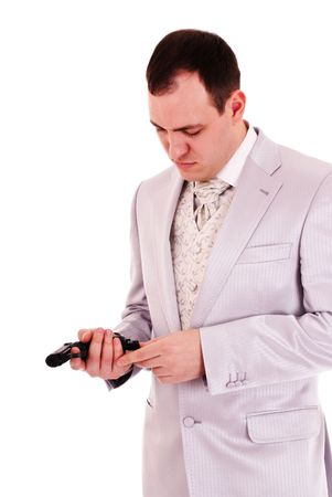 reload: man in white suit reload the gun, white background