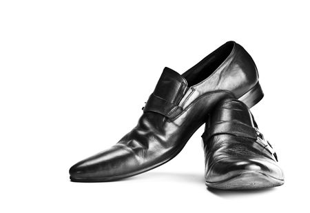 clasp feet: black male shoes with buckles isolated on white background Stock Photo