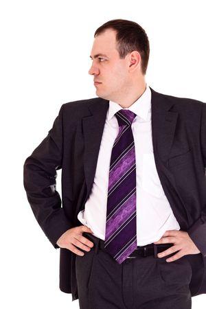 serious businessman looks somewhere, white background photo