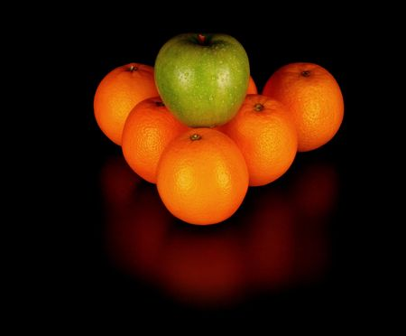 fruits like billiard balls on black background photo