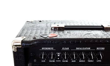 two plectrums on guitar amplifier, white background photo