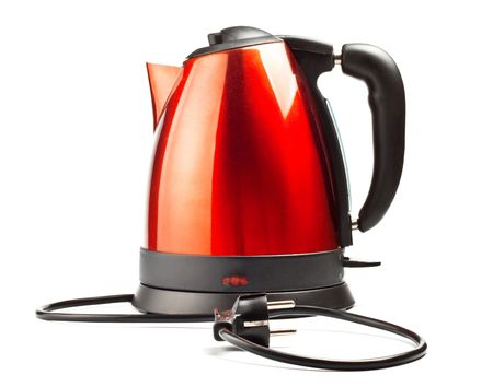 red and black electrical tea kettle isolated on white background photo