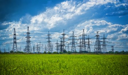 summer meadow with high-voltage towers row Stock Photo