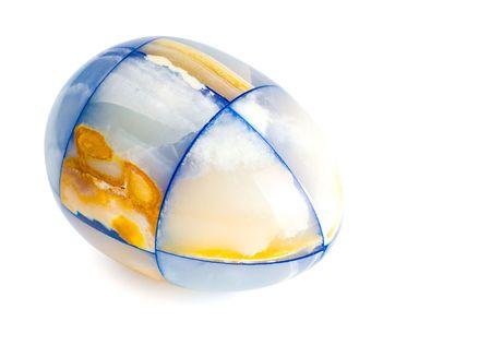 laying marble egg isolated on white background photo
