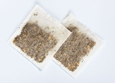 herbal tea bags laying on table, top view photo