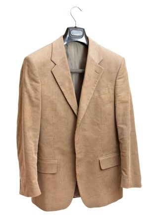 beige jacket on hanger isolated on white background Stock Photo