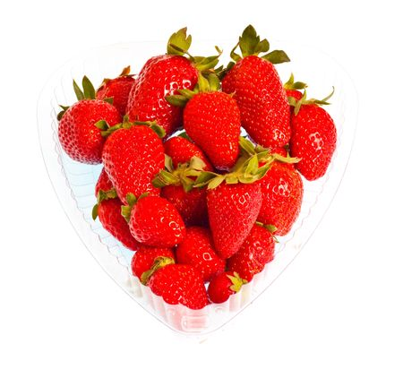 strawberries in heart-shaped pack isolated on white background photo