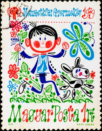 narcotism: HUNGARY - CIRCA 1979: postage stamp shows crazy boy running with dog, circa 1979