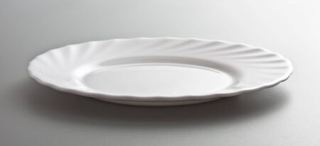 empty white dish, grey background photo