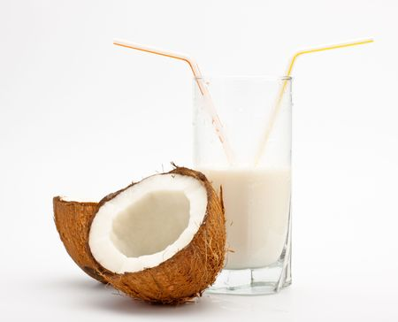 coconut and glass with coco milk, grey background photo