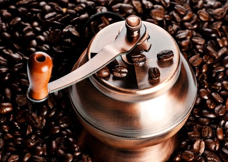 vintage coffee mill in beans, closeup