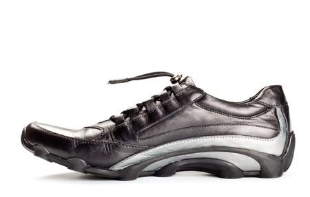 clasp feet: single sport shoe isolated on white background
