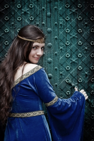 smiling medieval girl opening terrible door