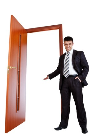 doors open: businessman invitate you to opened door Stock Photo