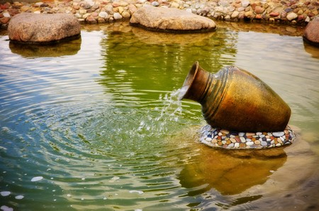 jugs: small fountain in metal jar Stock Photo
