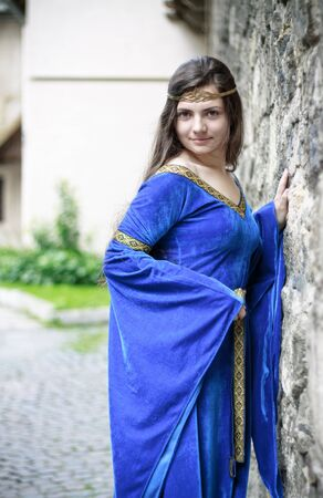 medieval princess on street of old town photo