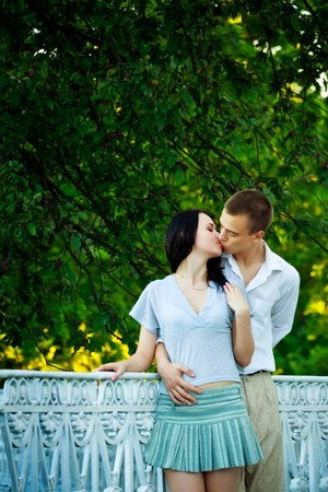 kissing couple in summer park photo