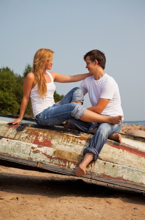 young couple sitting on old boat photo