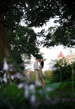 kissing couple in the park, view from branches photo