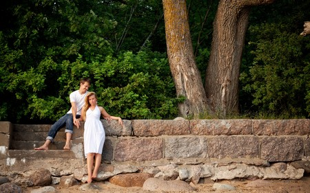 young couple stand next stonewall in forest Stock Photo - 7662169