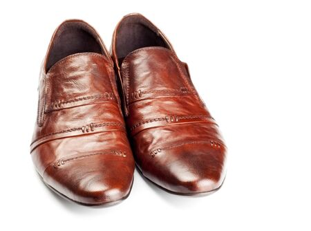 clasp feet: brown shoes pair isolated on white Stock Photo