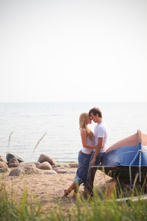 beautiful couple on a beach near old boat Stock Photo - 7739979
