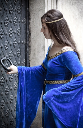 medieval girl opening terrible door photo