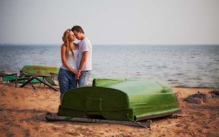 beautiful couple embrace on a beach Stock Photo - 7739836