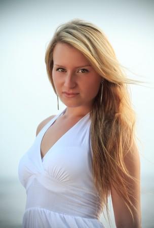 beach blond hair: beautiful woman portrait