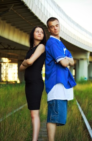 young couple on rails photo