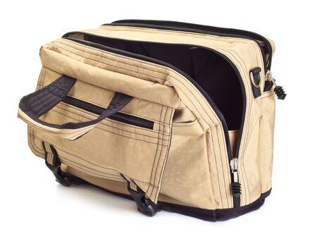 opened bag: opened beige travel bag isolated on white