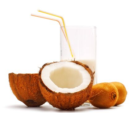 halves of coconut, kiwi and glass with coco milk Stock Photo - 8111748