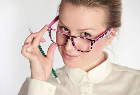 teacher in funny eyeglasses with pen photo
