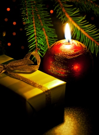 christmas card with candle and gift box