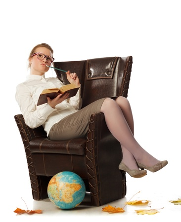 sexy business woman: pretty female teacher sitting in armchair
