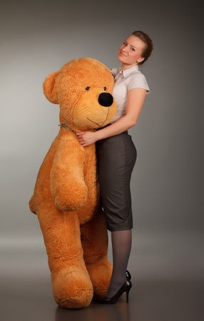 beautiful girl with funny toy bear photo