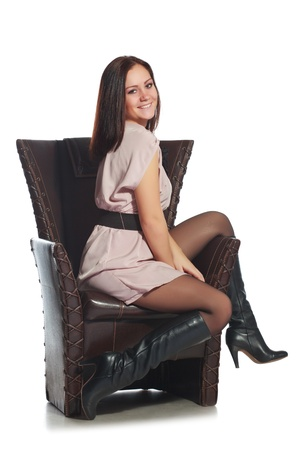 black stockings: beautiful girl sitting on chair, isolated on white