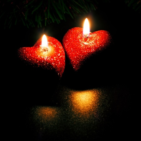 christmas card with two heart-shaped candles Stock Photo