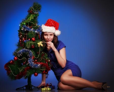beautiful girl lay near christmas tree photo