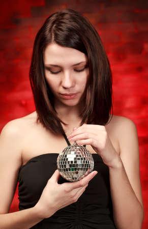 beautiful girl with decoration ball photo