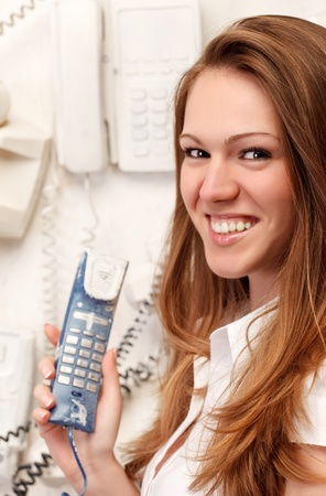 pretty smiling girl with old phone Stock Photo - 8533626