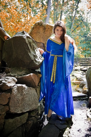 beautiful medieval princess in autumn stone garden photo