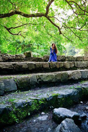 beautiful elf princess sitting on stone staircase photo